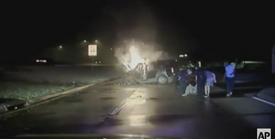 Dashcam Footage: Officers Rescue Driver From Burning SUV
