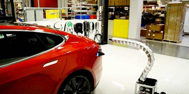 Futurastic New Tesla Charger Prototype Plug Itself Into Car